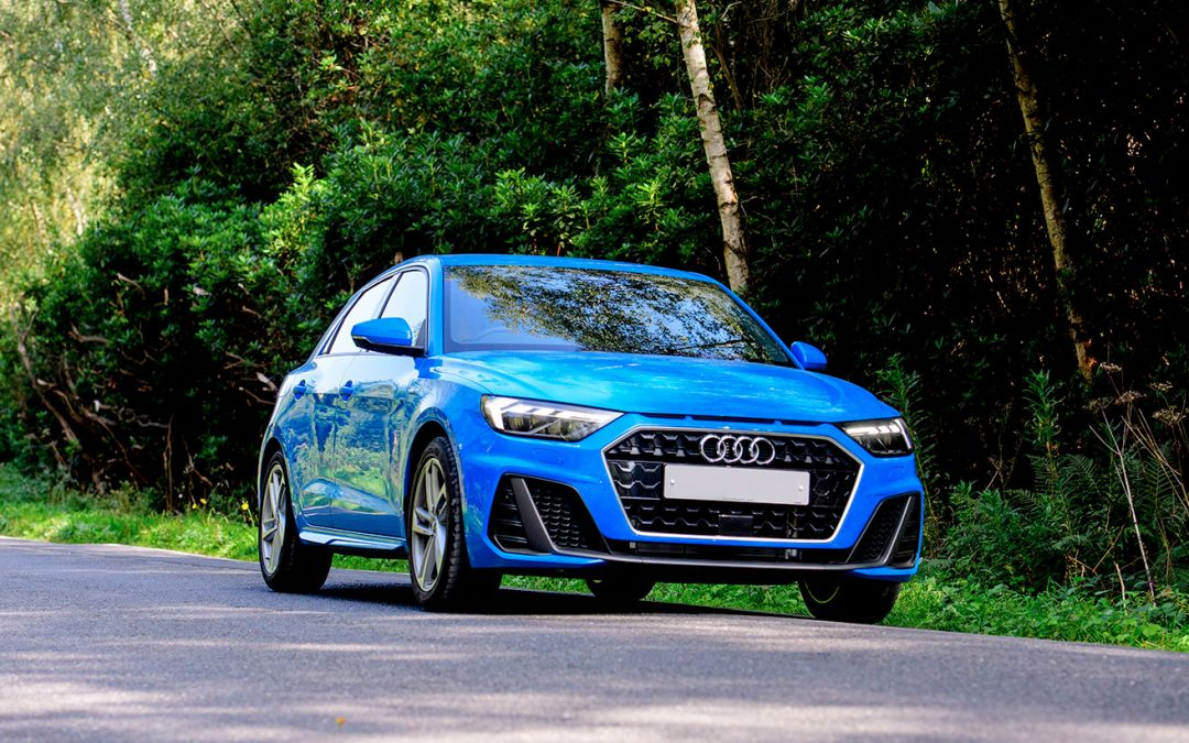 Audi A1 parked at the road side