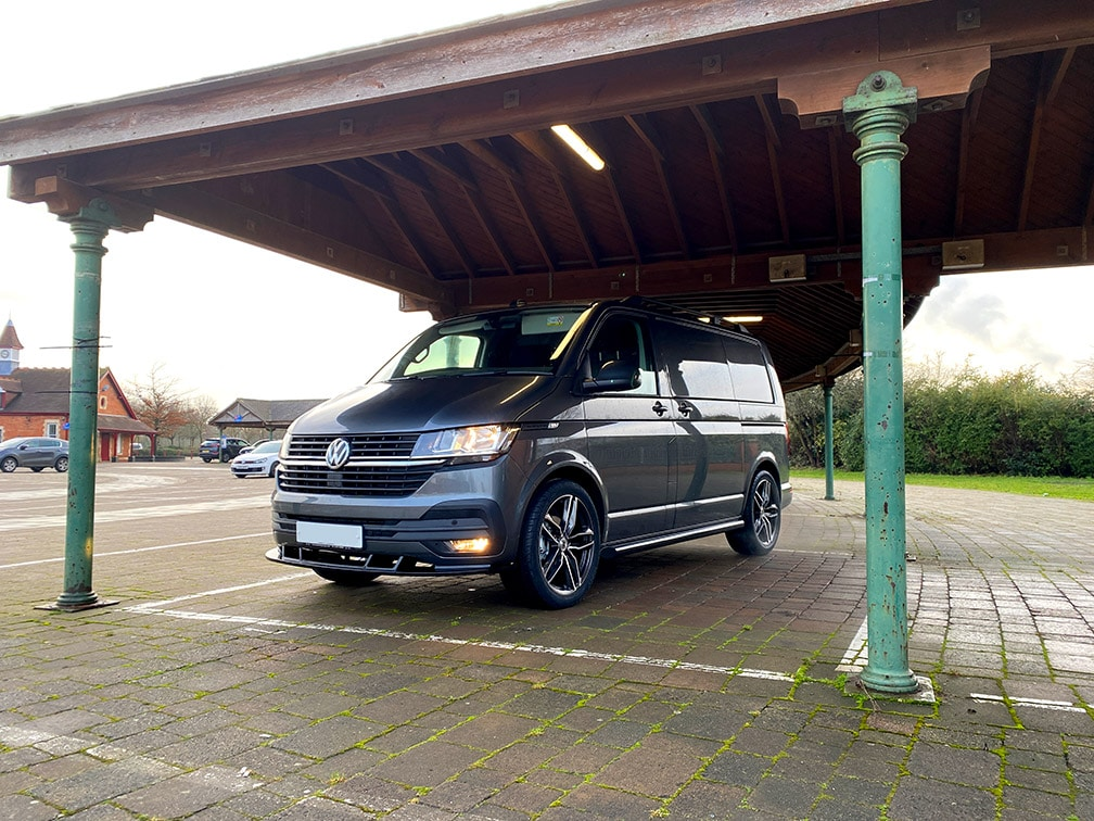 VW Transporter parked under a canope