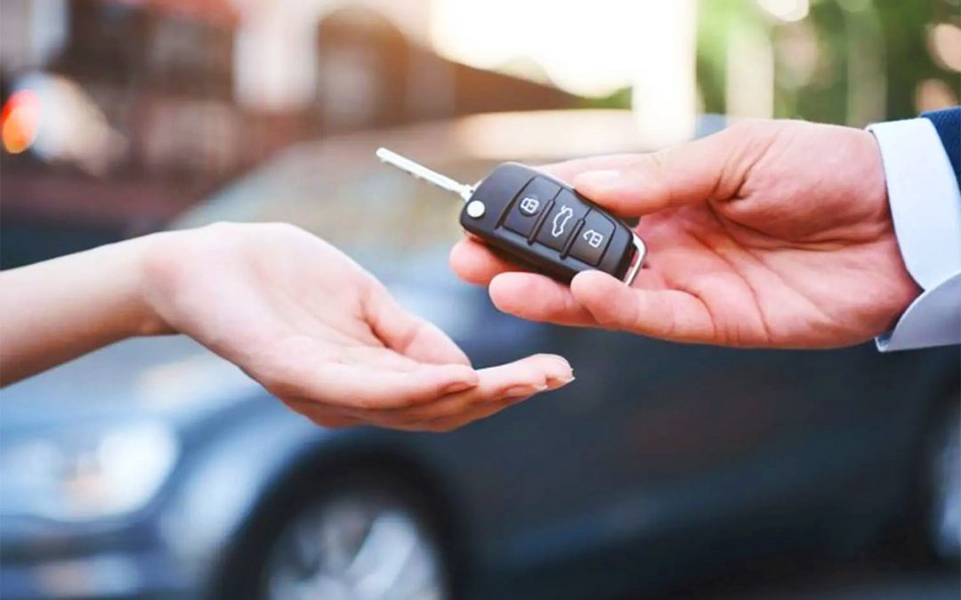Someone handing over car key